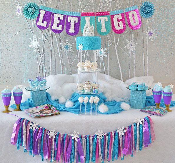 Frozen birthday party. The Let It Go birthday banner and ribbon garland are so cute! I love the pink, purple, blue and silver color combo.