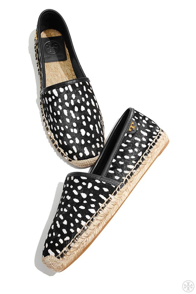 A city-friendly take on the quintessential beach shoe - black and white  espadrilles by Tory Burch