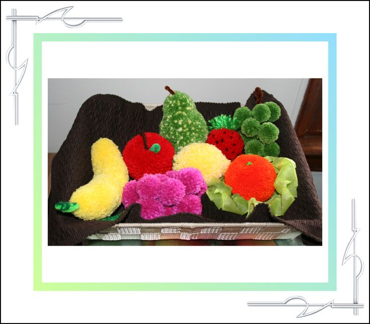 The fruits in this basket are made from yarn. I call them Sculptured Yarn, but they're usually known as pompoms. These and others can be purchased at Thatissocool.ca.