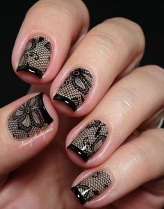 Amazing black net and floral nail art design with French tips. Add a bit of drama into your nails by creating this well detailed and intricate looking design in black polish.