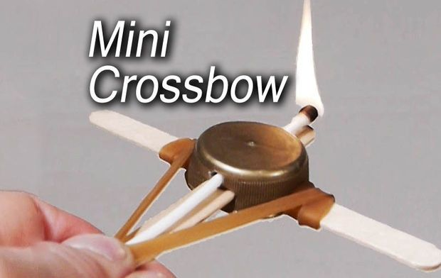 Mini crossbows from Popsicle sticks, bottle caps and toothpicks