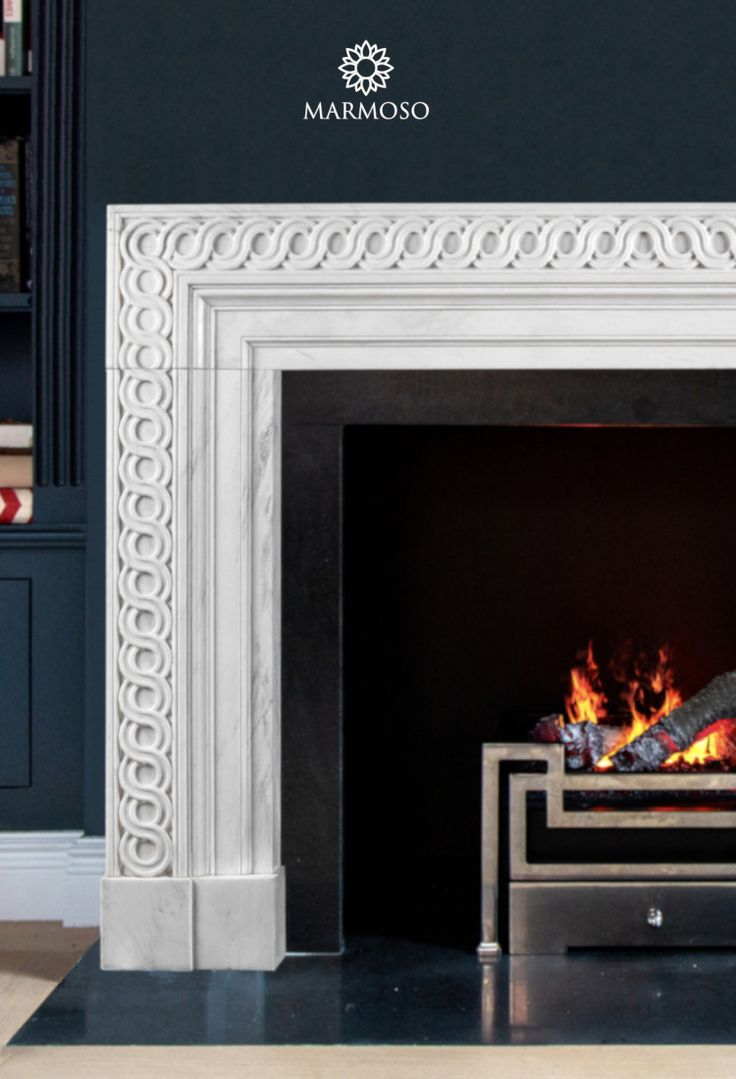 Modern marble fireplace mantel by Marmoso