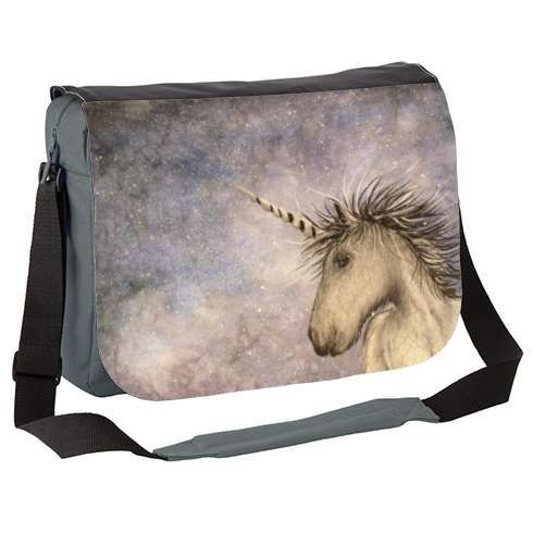 Unicorn Skies Messenger Bag by carolinelord   A fantastical image featuring a single unicorn, travelling through a snowy winter's night in search of another of his kind