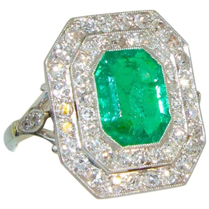 Antique Emerald and Diamond Platinum Ring | From a unique collection of vintage fashion rings at https://www.1stdibs.com/jewelry/rings/fashion-rings/
