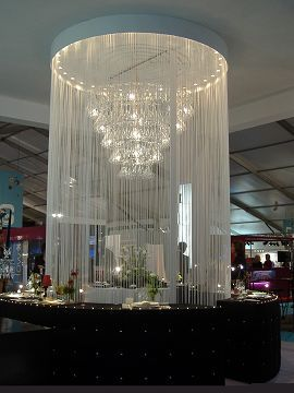 chandelier covered by long fringe curtain strings