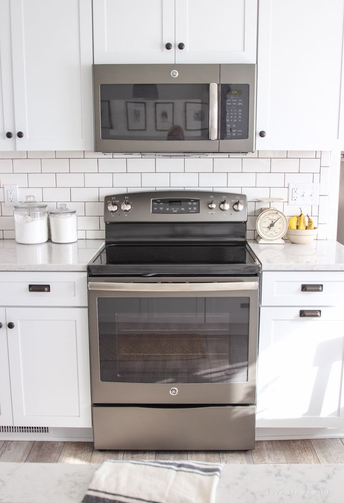 Follow along the makeover of this beautiful farmhouse kitchen! In this post, Liz shares the appliances she picked and why. Click for more photos and details!