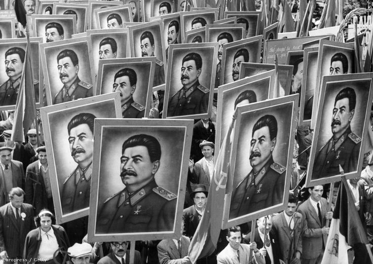 Citizen marchers carrying posters of joseph stalin at a may day parade in bucharest, romania, 1950s. Photo by: Sovfoto/UIG via Getty Images