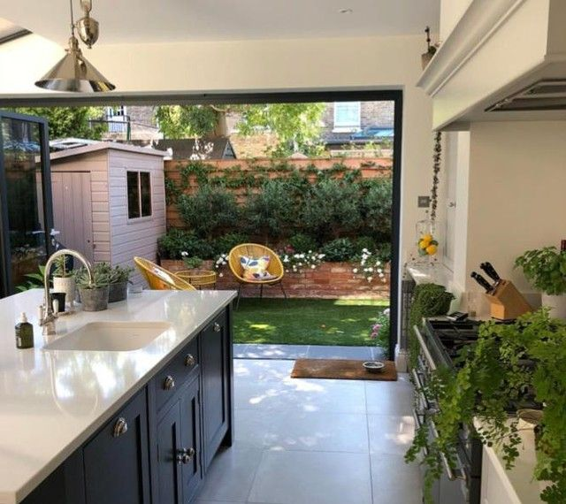 Small Yard Idea With Bi-fold Doors Leading From Kitchen