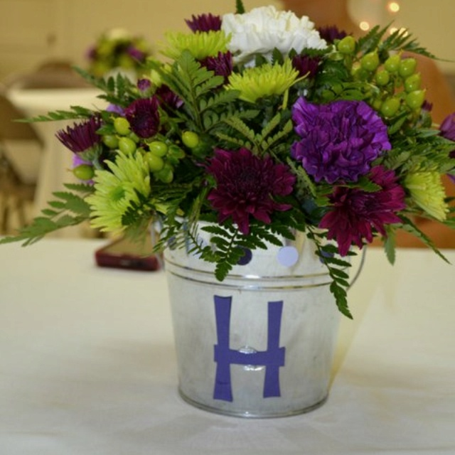 Silver bucket centerpieces $1 at target, letters cut with cricut machine. Centerpieces for wedding