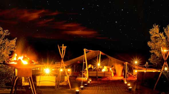 La Pause. A nomad desert tent riad. The Agafay valley is a rough, dry, red moon-like desert 40 minutes south-west of Marrakech. And within it is La Pause, a green oasis set beside a riverbed, in startling contrast to the arid land surrounding it. The resort was conceived when Frenchman Frédéric Alaime came to the area for a spot of horse riding in 2003 and decided  that he'd like to build a home there