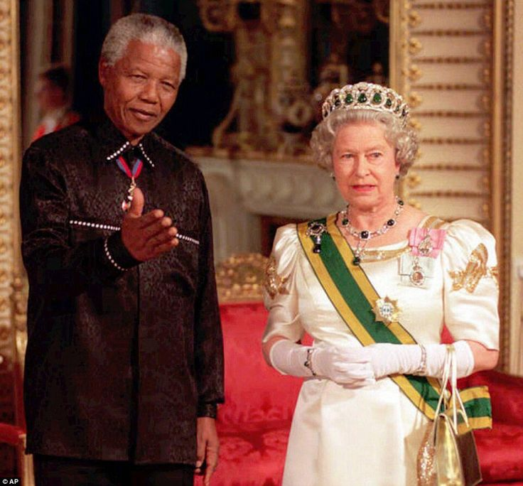 Royal reception: In this July 9, 1996 file photo, South African President Nelson Mandela stands with Queen Elizabeth II on his arrival at Buckingham Palace in London for a state banquet in his royal visit.