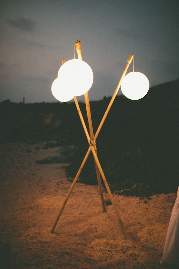 Lanterns on poles for a beach wedding. Photography By / paigejones.co, Floral Design By / rosemarystafford.com