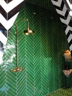 Emerald green herringbone tiled shower
