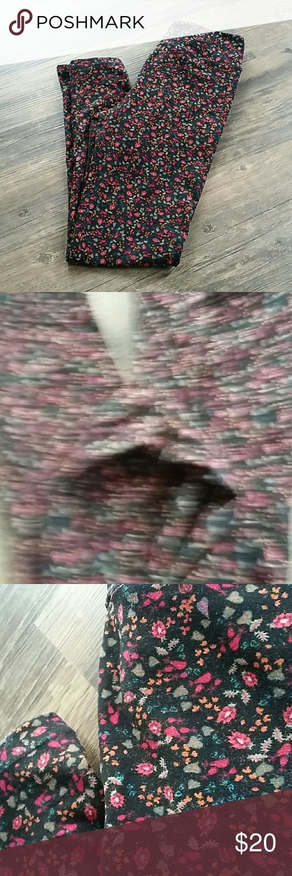 Lularoe OS leggings floral print Excellent used condition Lularoe OS leggings in a pretty floral print - black background with magenta cored flowers and olive colored leaves, also hints of blue and orange - no trades! Offers welcome! Bundle to save :) LuLaRoe Pants Leggings
