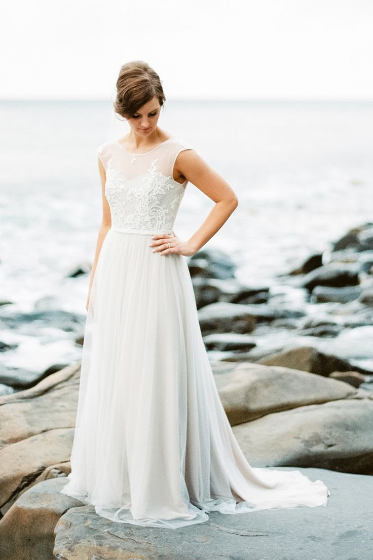 Elegant embroidered wedding dress with soft skirt | When Elephant Met Zebra | See more: http://theweddingplaybook.com/bright-waterfront-cocktail-wedding/