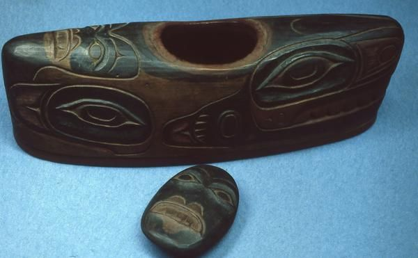 Wooden soul catcher, carved in the image of a killer whale. Atypical of soul catchers, this particular one has an excavated body with a detached lid.