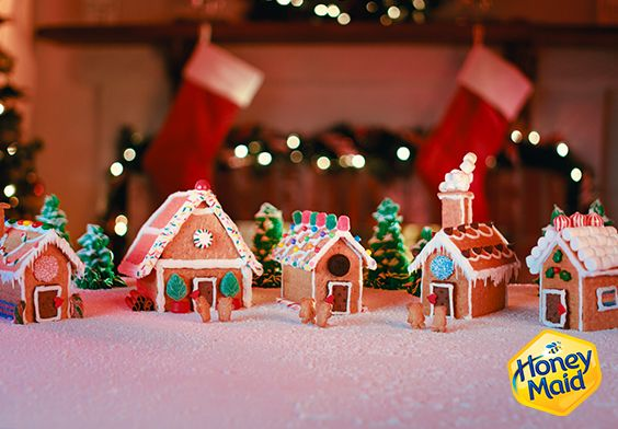 Graham Cracker Houses are all the rage this Holiday Season! Grab the treats, candy, icing and of course the Honey Maid Graham Crackers to create this awesome Holiday Village. A fun holiday activity to do with the kids, or the whole family! * Ingredients:   1 Box Honey maid chocolate grahams 1 Box Honey maid honey grahams 1 Box Teddy Grahams 1 tub Ready-to-spread white frosting Assorted festive & edible decorations