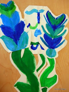 "Painting symmetric flowers in response to ""Planting a Rainbow"" by Lois Ehlert"