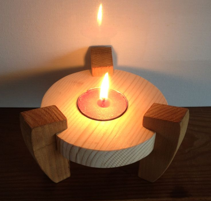 T-light candle holder I made with my scroll saw. Simple & easy . Stained the legs an left holder plain wood for a two tone effect.