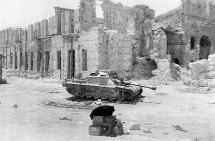 Stug III from an unidentified unit sits in Piazza S. Antonio.