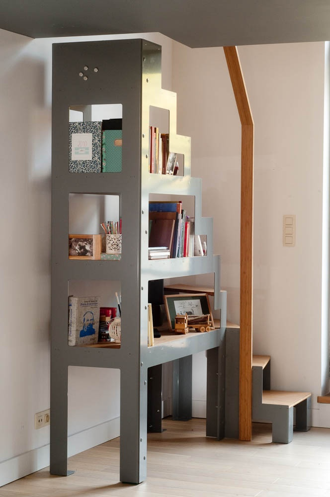 The Libro stairs, stands like a bookshelf.  By the way, it may be used as a bookshelf too :)