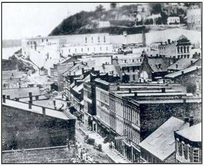 Downtown Alton.  The old Alton Penitentiary can be seen in the background  as  a large-three story structure