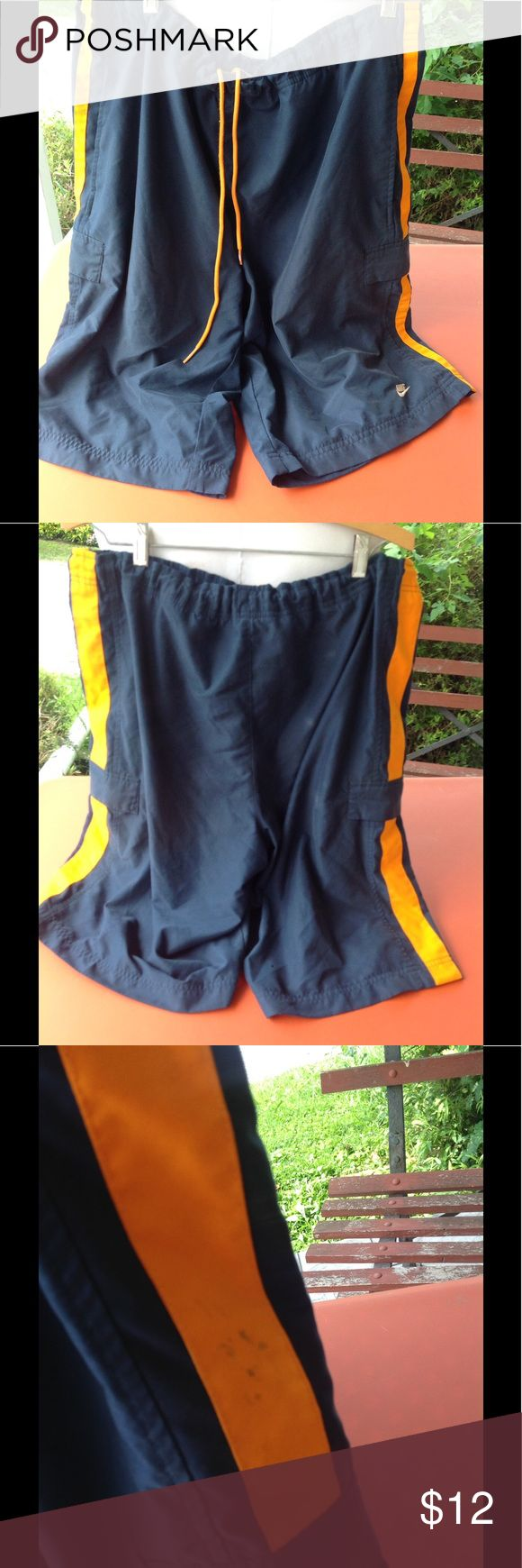 Mens nike shorts. They are a size xlarge, color is dark blue and orange, has some stains on the right side and a small hole, and some fading spot on the back, sale is final i do not accept returns. Nike Shorts Athletic