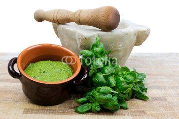 pesto sauce with mortar and pestle