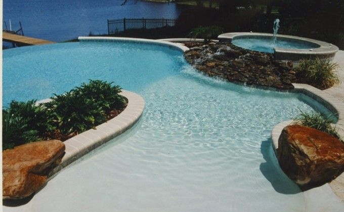 Awesome rock waterfall spa and beach entry with rock accents natural springs pools for - Beach entry swimming pool designs ...