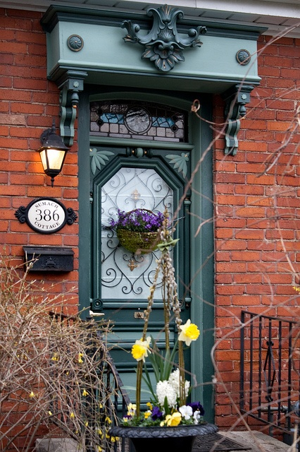 Doorway in Cabbagetown, Toronto in a Victorian neighborhood.  Notice the details of the scrollwork, and the stained glass and corbels above the doorway!