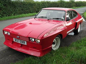 Modified ford capri, looks like a cross between an X Pack and a Tickford kit.