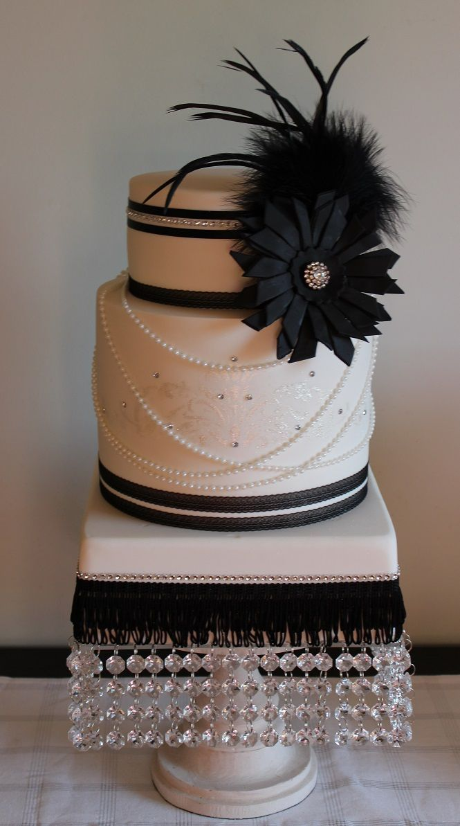 http://rubies.work/0081-ruby-rings/ Black and white Gatsby-inspired wedding cake - so beautiful