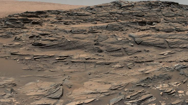 Large-scale crossbedding in the sandstone of this ridge on a lower slope of Mars' Mount Sharp is typical of windblown sand dunes that have petrified - Image credit: NASA/JPL-Caltech/MSSS