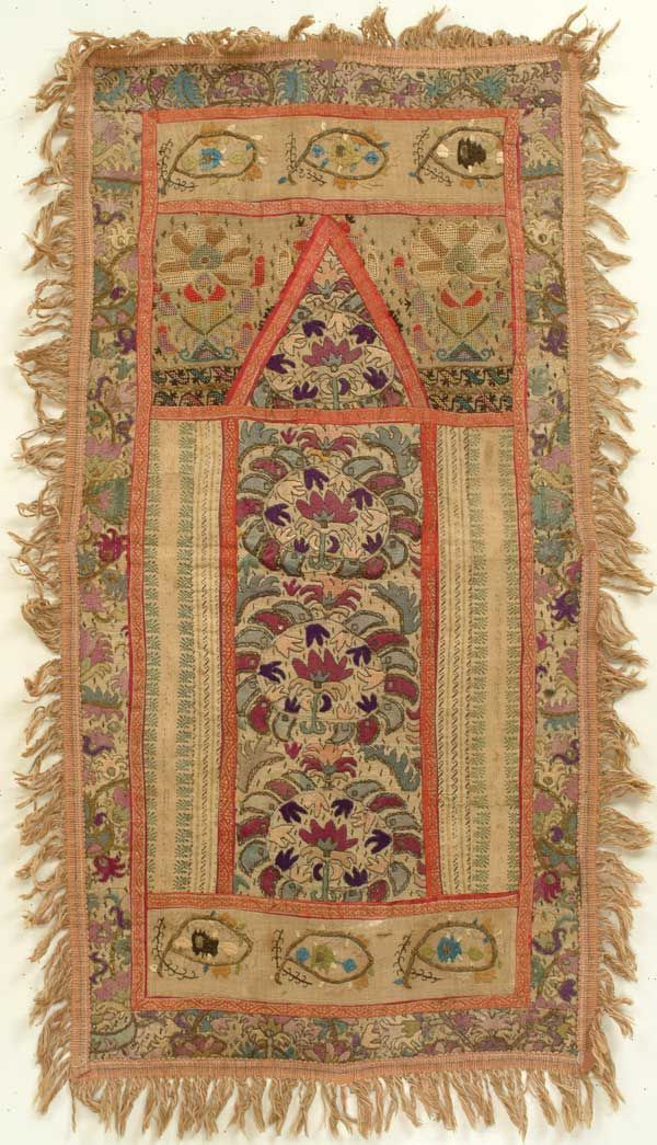 A 'seccade' (prayer carpet); Late-Ottoman (Turkey). Composed in late 19th c. from fragments of older vintage, silk and metallic thread embroidery on cotton and linen.