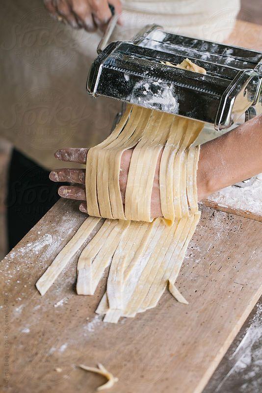 Woman making fresh pasta with fresh ingredients.