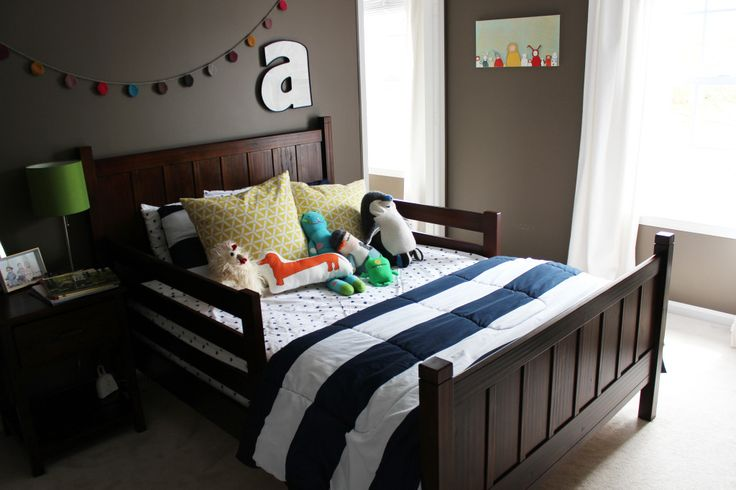 We love this bold choice in paint color, which is brightened by bedding and accents! #bigboyroom
