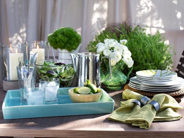 Buffet-style serving is a much more practical approach to outdoor entertaining than a formal spread. To play up the pastel blues and greens of this palette, serving dishes and tableware in the same shades were grouped together on the table--> http://hg.tv/y8wl