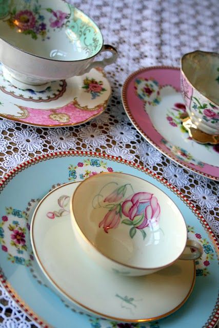 very pretty! I love the tablecloth and the tea cups! I think I need to have a tea party some day!