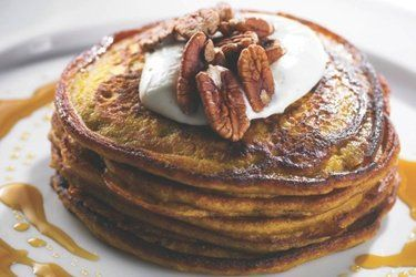 Pumpkin pancakes - quinoa bulks these out. bet they'd be delicious with bacon & maple syrup.