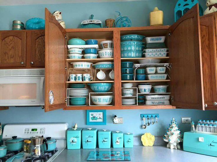 Turquoise vintage kitchen. Canisters, pots and pans, bread boz, pyrex
