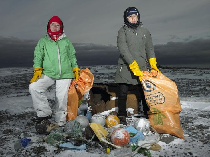Campaigners in the Arctic. Greenpeace Campaigners Gulcin Sahin from Turkey (left) and Beatriz Olivera Villa from Mexico (right) clean up a beach in Moffen Island of waste that has washed ashore. Many of the items are from the fishing industry. Greenpeace is on a month-long expedition in the icy Arctic. Greenpeace is campaigning for a global sanctuary to be declared around the uninhabited area of the North Pole. Photographer: Naomi Harris / Greenpeace