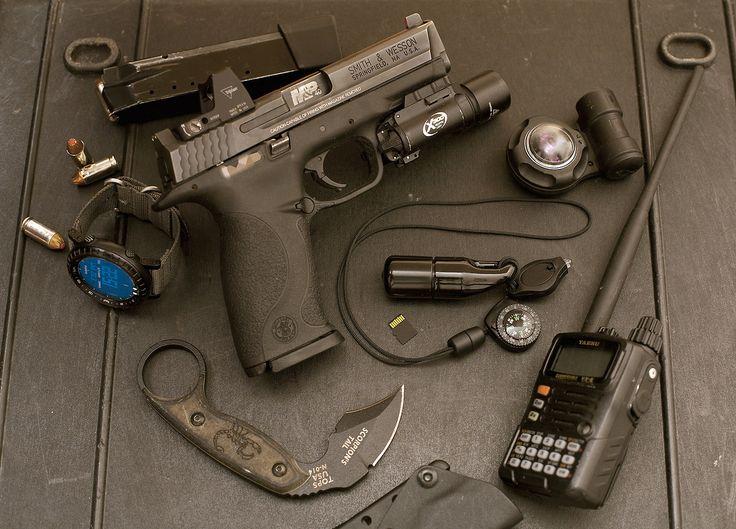 Smith & Wesson M&P40 w/Trijicon RMR and SureFire X300. Suunto Core Watch