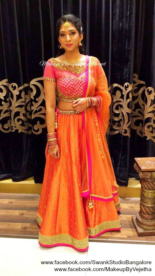 Ramya looks gorgeous for her engagement ceremony in a bridal lehenga. Makeup and hairstyle by Vejetha for Swank Studio. Photo credit: Manish Ananda. Pink lips. Bridal jewelry. Bridal hair. Lehenga love. Indian Bridal Makeup. Indian Bride. Gold Jewellery. Tamil bride. Telugu bride. Kannada bride. Hindu bride. Malayalee bride. Find us at https://www.facebook.com/SwankStudioBangalore