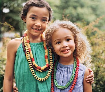 Use fancy pasta shapes and gel-based or liquid food coloring to create fun necklaces with the kids.
