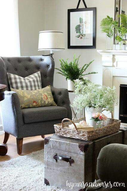 Neutral living room with chair and old trunk