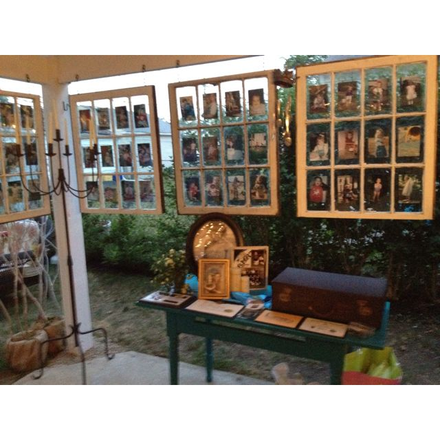 I used old windows to display photos for daughters Graduation Party!!!