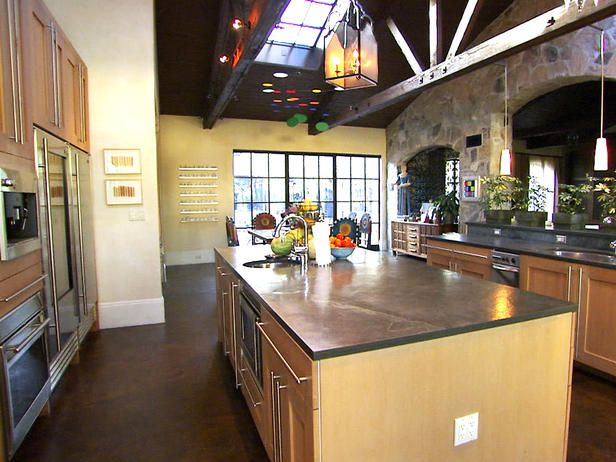 Modern Italian-style kitchen that features rift sawn oak cabinets, skylights, stainless steel appliances and slate counter-tops. Love the arches over the counter that separates the two rooms.