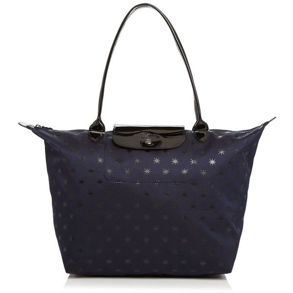Longchamp Le Pliage Etoiles Large Nylon Tote ($195) ❤ liked on Polyvore featuring bags, handbags, tote bags, navy blue purses, navy blue handbags, nylon tote, nylon tote bags and blue tote