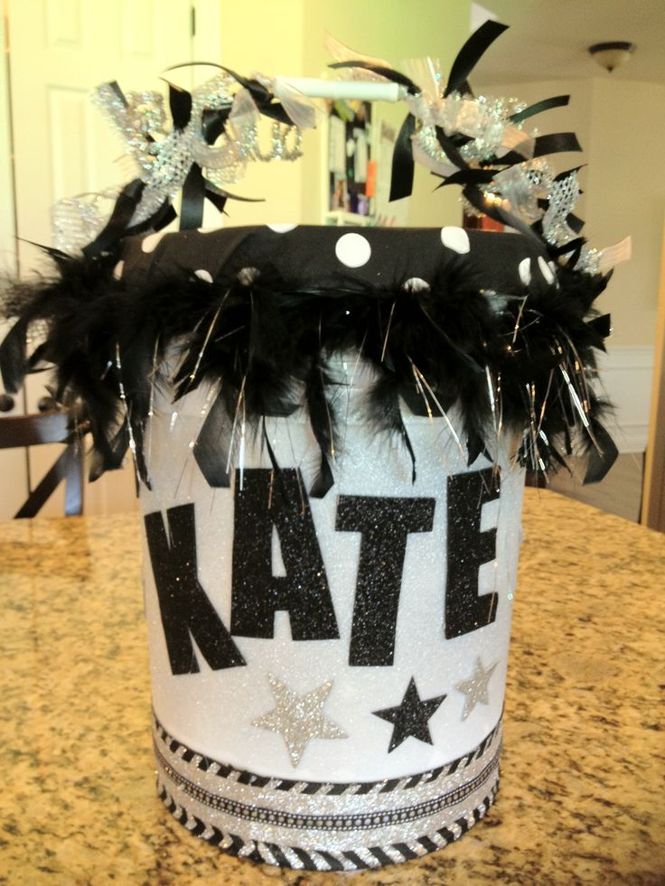 Cheer bucket or sit-upon:  Krylon glitter blast in silver, feather boa, chevron and other ribbon, glitter foam for letters.  Bought everything at Michaels except the fabric and foam cushion.  Not too difficult - hardest part was tying all the ribbon around the handle!!