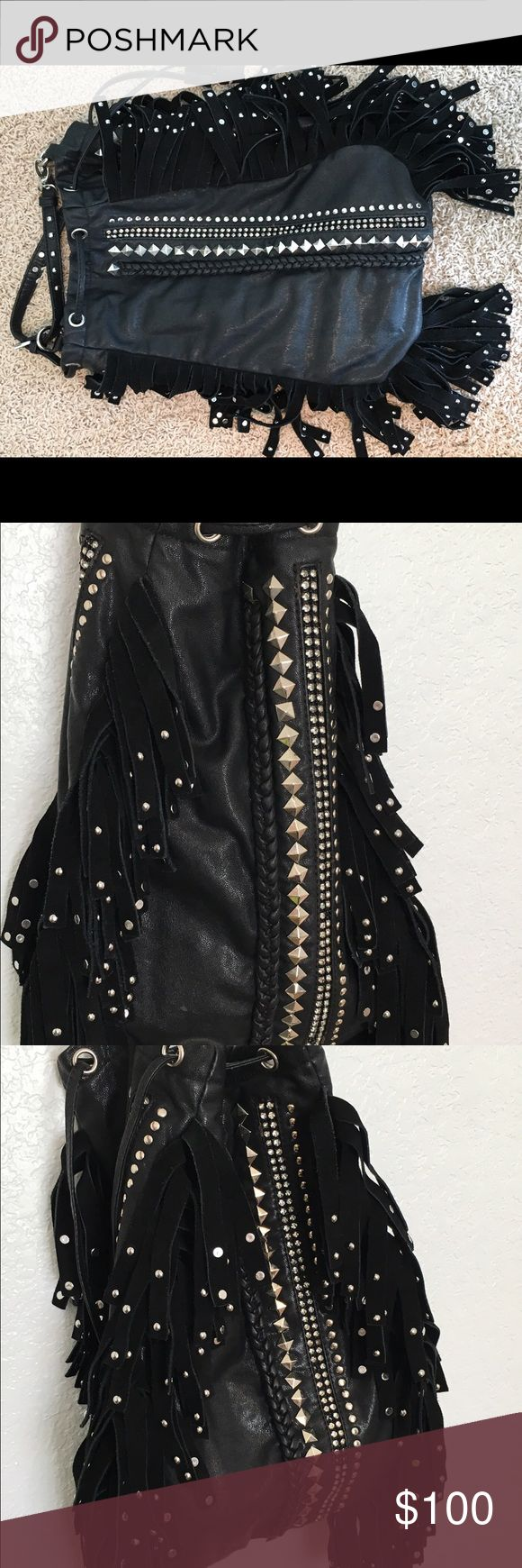 Tassel leather studded bucket purse Real leather black studded awesome bag! I found this gem at a fancy store at the Vegas airport one year! leather Bags Hobos